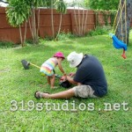 Helping daddy fix the weed whacker